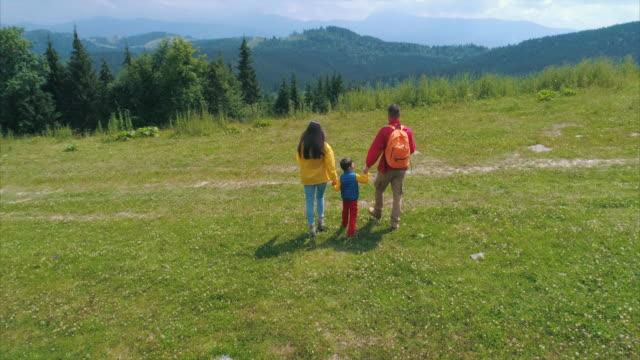 family on mountain in daytime - mountain range stock videos & royalty-free footage