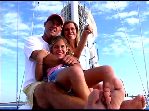 family on sailboat - bald head island stock videos & royalty-free footage