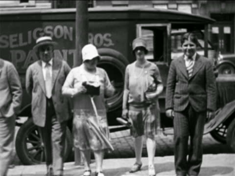 b/w 1925 family on sidewalk walking towards camera outdoors / home movie - 1925 stock videos & royalty-free footage