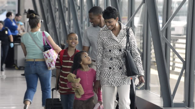 WS TS Family on Summer Vacation Walking through Airport / Dulles, Virginia, USA