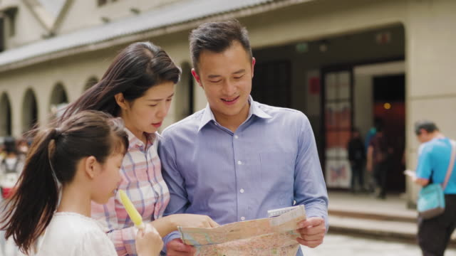 a family on vacation in taipei looking at a map - taipei stock videos & royalty-free footage