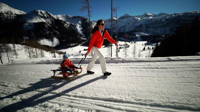 family on winter holidays on sled run - ski jacket stock videos & royalty-free footage