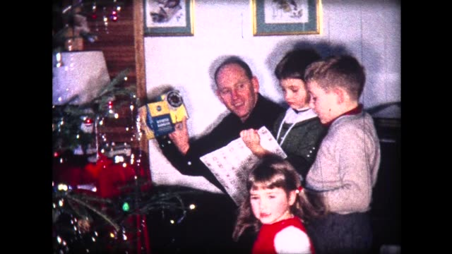 1963 family opening presents on christmas morning - christmas gift stock videos & royalty-free footage