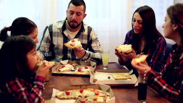 family or friends sharing a pizza - sharing stock videos & royalty-free footage