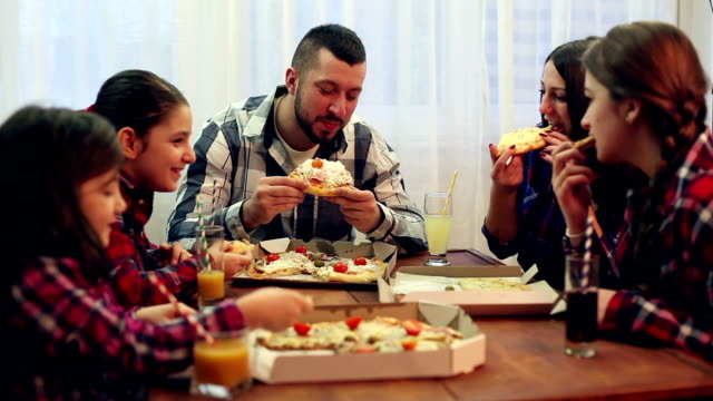 family or friends sharing a pizza - take away food stock videos & royalty-free footage