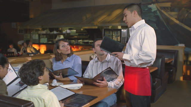 ms family ordering meal from waiter in restaurant / san antonio, texas, usa - boys stock videos & royalty-free footage