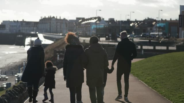 family out for a walk - whitley bay stock videos & royalty-free footage