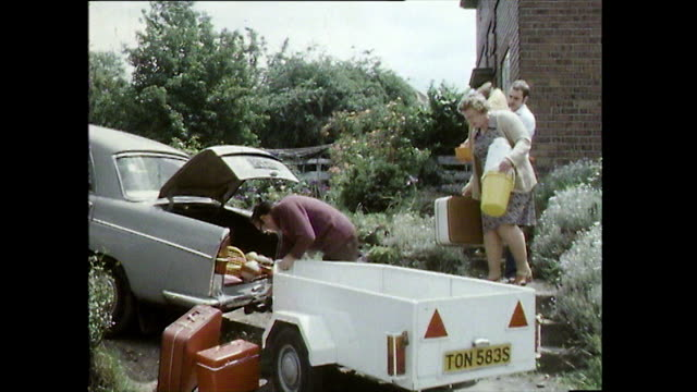 family packing car and trailer with camping equipment; 1978 - packing stock videos & royalty-free footage