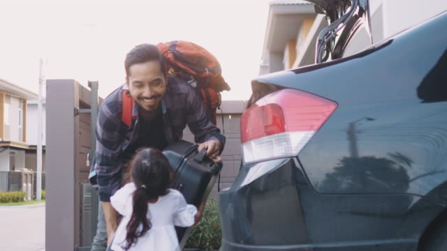 family packing car ready for summer vacation - bagaglio video stock e b–roll