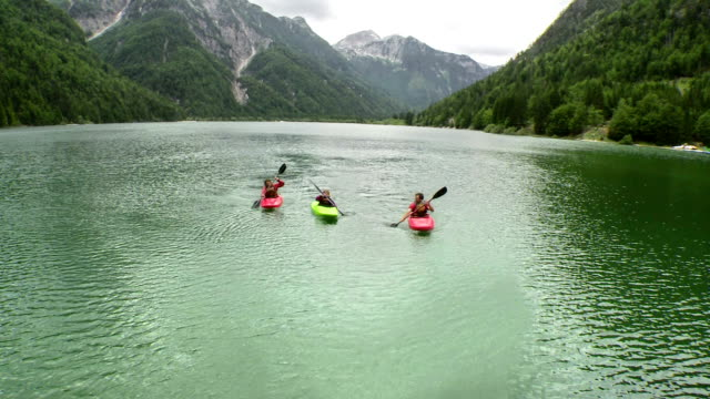 hd: family paddling on the lake - kayak stock videos & royalty-free footage
