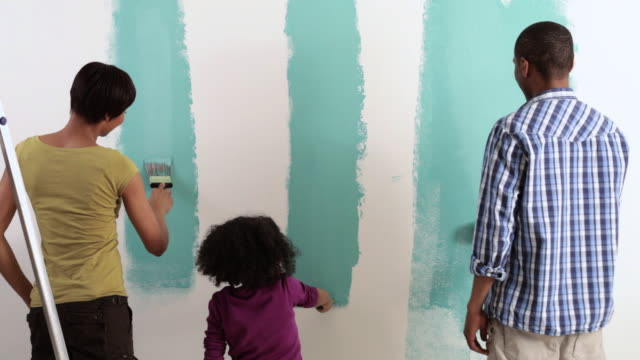 Family painting wall