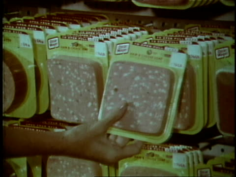 1970 MONTAGE Family picks package of Oscar Mayer lunch meat from supermarket and puts it in cart