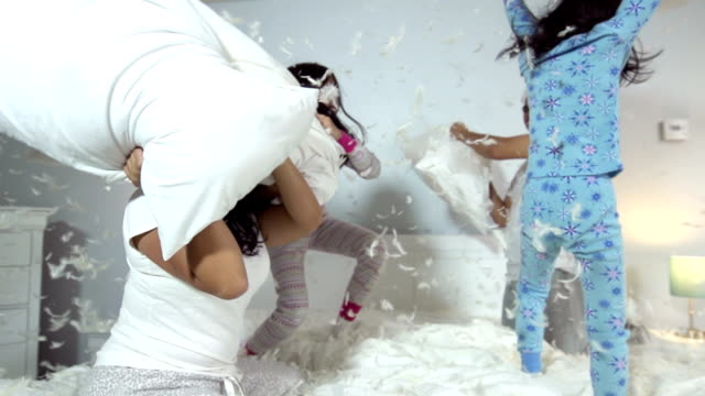 family pillow fight - mischief stock videos & royalty-free footage