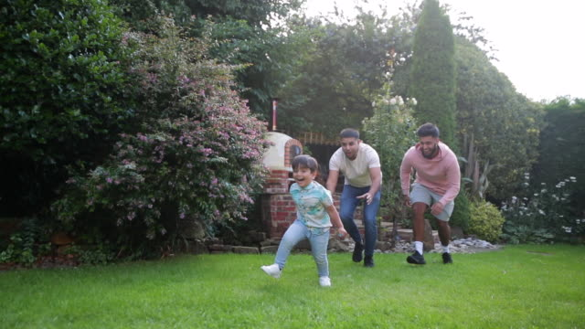 family play time outdoors - playing stock videos & royalty-free footage