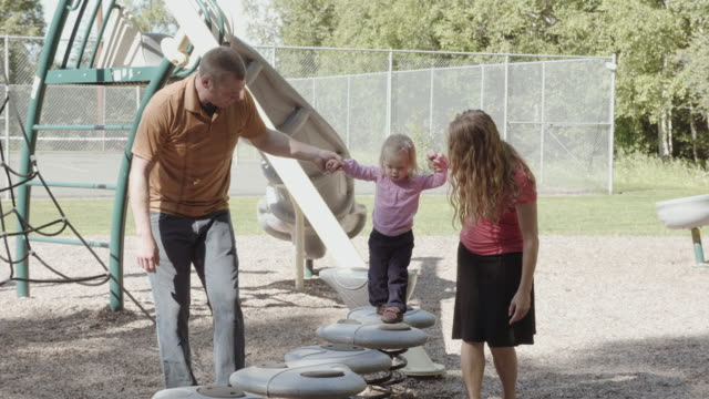 uhd 4k: family playing and spending time together in a park - middle class stock videos and b-roll footage