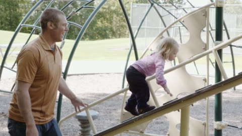 uhd 4k: family playing and spending time together in a park - encouragement stock videos & royalty-free footage