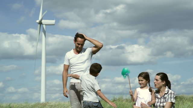 MS Family playing around in wind farm / Toulouse, Midi-Pyrenees, France