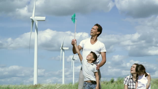 ms family playing around in wind farm / toulouse, midi-pyrenees, france - leksak bildbanksvideor och videomaterial från bakom kulisserna