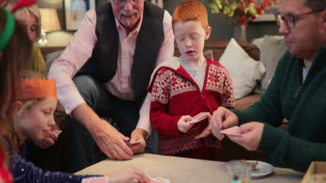 family playing cards together - toy stock videos & royalty-free footage