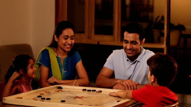 ms family playing carrom game at home / sonipat, haryana, india - carrom stock videos & royalty-free footage