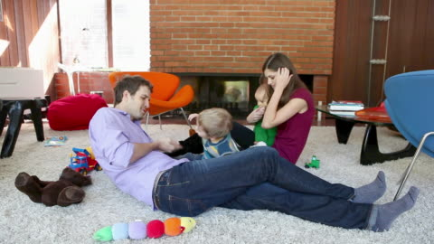 family playing in living room - flooring stock videos & royalty-free footage