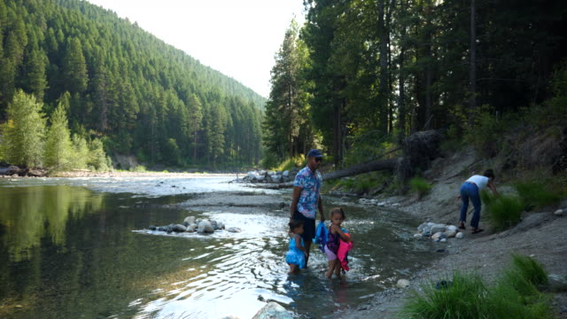 ws family playing in river on summer afternoon - life jacket stock videos & royalty-free footage