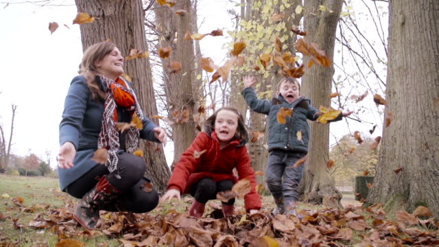 Family Playing In The Autumn Fall