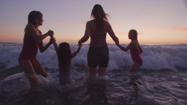 family playing in the water together - potere femminile video stock e b–roll