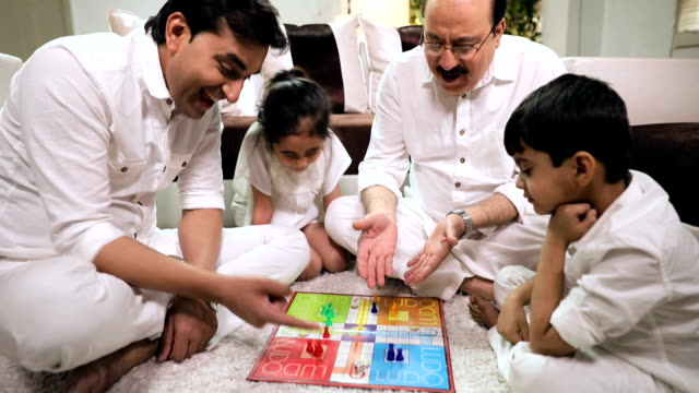 family playing ludo in the home, delhi, india - enjoyment stock videos & royalty-free footage