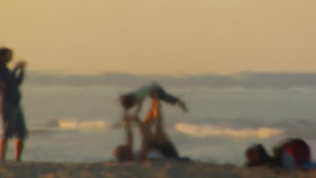 MS, DEFOCUS, Family playing on beach, North Truro, Massachusetts, USA