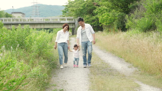 family playing outside - japan videos stock videos and b-roll footage