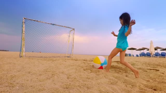family playing soccer. greek island - soccer goal stock videos & royalty-free footage
