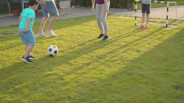 family playing soccer - messing about stock videos & royalty-free footage