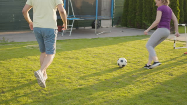 family playing soccer - front or back yard stock videos & royalty-free footage