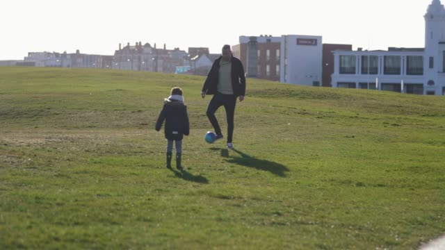 family playing soccer - whitley bay stock videos & royalty-free footage