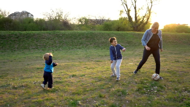 family playing soccer - public park stock videos & royalty-free footage