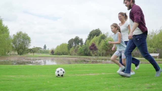 family playing soccer - golf club stock videos & royalty-free footage