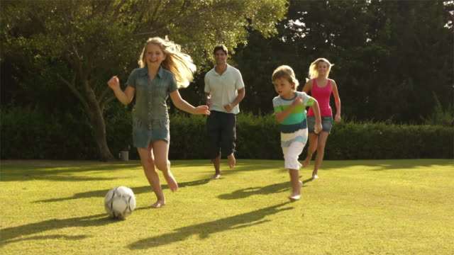 Family playing soccer/Sotogrande,Spain