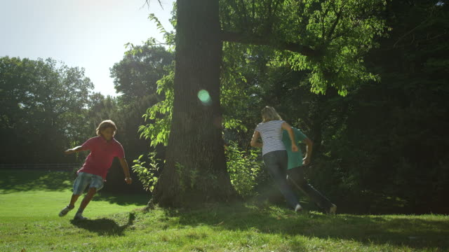 family playing tag - playing tag stock videos & royalty-free footage