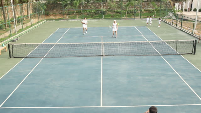 family playing tennis  - tennis stock videos & royalty-free footage
