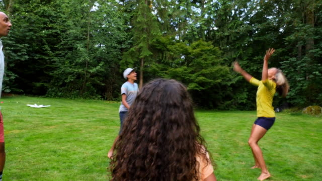 MS Family playing together in backyard on summer evening