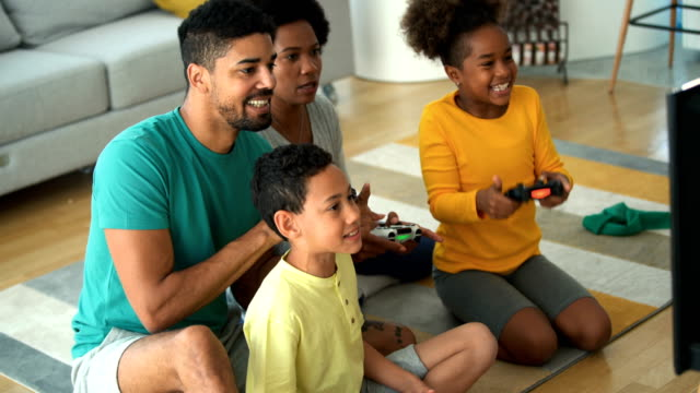 family playing video games at home. - family with two children stock videos & royalty-free footage