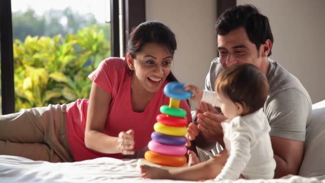 family playing with a plastic toy  - indian mom stock videos & royalty-free footage