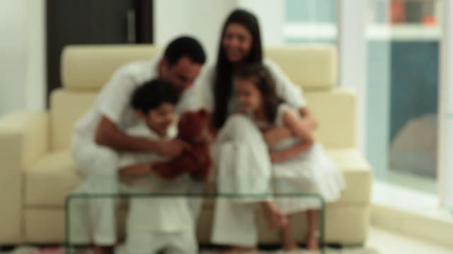 Family playing with a toy