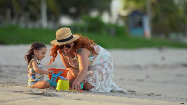 family playing with beach sand - swimming costume stock videos & royalty-free footage