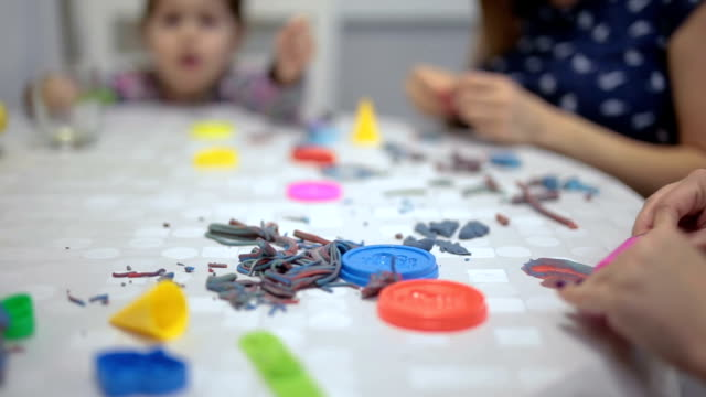 Family playing with children's clay