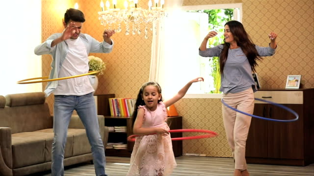 family playing with hula hoop at home, delhi, india - indian subcontinent ethnicity stock videos & royalty-free footage