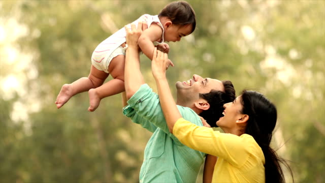 ms zi family playing with their baby boy in backyard / delhi, india - young family stock videos & royalty-free footage