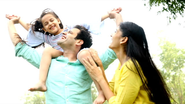 ms family playing with their daughter in backyard / delhi, india - young family stock videos & royalty-free footage