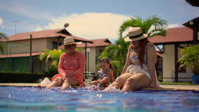 family playing with their feet in the water in the pool - walking in water stock videos & royalty-free footage